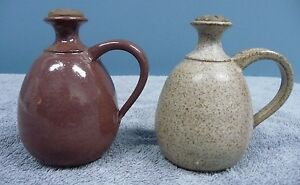 Pair of Small Pottery Urns With Clay Lids