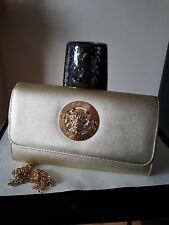 women gold colour  medium size lap over clutch purse evening  handbag