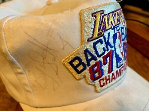 Lakers Ball Cap Signed by Byron Scott plus Pic. of Signing. Good Condition.