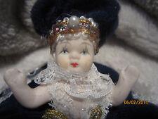 Vintage porcelain miniature baby queen doll