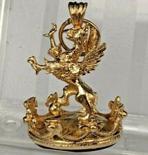 A magnificent large 9ct gold watch fob seal of a golden griffin on a crown