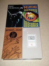 Lot of 4 VHS Def Leppard Historia Eric Clapton Eagles Judas Priest Live