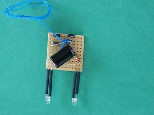 TRAIN.HO. PLATINE  FEUX FIN DE CONVOI. 2 LEDS ROUGES TRANSLUCIDES. 3 mm