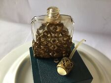 vintage small perfume bottle With Decorative casing .