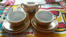 Japan lusterware child's tea set pieces peach color with dragon and floral