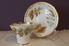 AYNSLEY ENGLAND TEACUP AND SAUCER CORSET SHAPED WITH GOLD TRIM