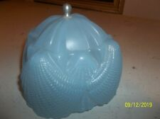 Very antique glass blue lamp shade with a shell pattern that clamps on a light b