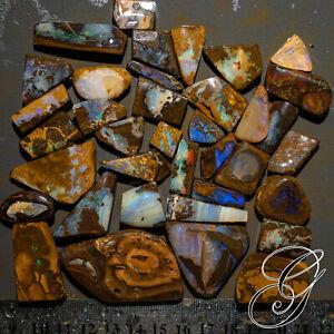 Natural unpolished rough boulder opal parcel 940 cts