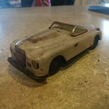 Working vintage tin friction toy car convertible