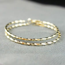 14k Gold plated large hoop twisted round earrings