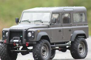 FM101 Landrover Defender Crawler 4WD RTR 1:8 RC Auto Wagon NEU in OVP