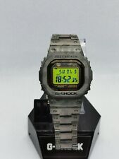 Casio G Shock GMW-B5000GD with green lcd and titanium camo bracelet and bezel