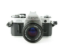 Canon AE-1 SLR + Lens FD 50mm 1:1.8 mit Gurt with strap