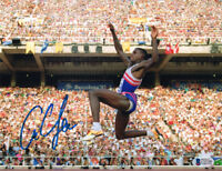 CARL LEWIS SIGNED 8x10 PHOTO OLYMPIC TRACK GOLD MEDALIST LEGEND BECKETT BAS