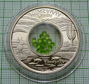 MESA GRANDE KUMEYAAY LANDS 2009 1 $ TOKEN, LIME COLOUR STONES INSERT IN CAPSULE