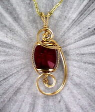RED RUBY  GEMSTONE  PENDANT  IN 14KT ROLLED GOLD WIRE WRAPPED WITH CHAIN
