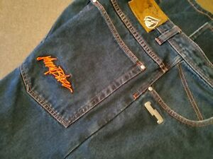 JOHNNY BLAZE BLUE JEANS MENS 44 X 30 LEATHER EMBROIDERED AND METAL LOGOS. NEW