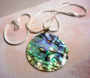 Artisan made round Abalone shell pendant on silver chain.