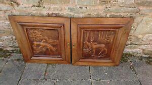 PAIR OF OLD CARVED WOODEN CUPBOARD DOORS FEATURING DEER