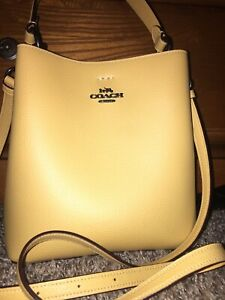 Coach small town bucket style purse. W/ Extra strap. Fall mustard Yellow Color.