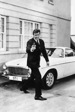Roger Moore in The Saint by classic Volvo car 18x24 Poster