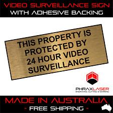 24HR VIDEO SURVEILLANCE  - GOLD SIGN - LABEL - PLAQUE w/ Adhesive 100mmx40mm