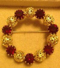 VTG Brooch-Gold Tone Wreath Shape With Filigree Gold Balls Garnet Color Stones
