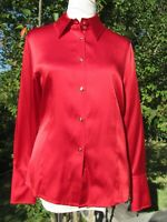 "St John red 95% silk button down blouse. Long sleeves. 5"" cuffs. Size 8."