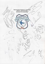 An A4 white card with the Cardiff City Badge. Signed by 13 players on 16.01.2016