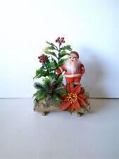 vintage santa with poinsettia on log Christmas decoration