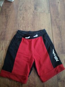 NIKE AIR RED/BLACK SHORTS AGE 12-13