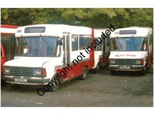 BUS PHOTO: RED & WHITE FORD TRANSITs 243 C318OFL & 248 C364GFJ