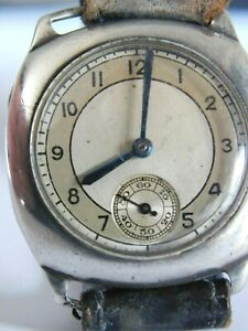 GENTS ANTIQUE SOLID SILVER WRISTWATCH - GENTS SILVER CUSHION WATCH