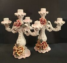 Pair of Capodimnonte candelabra. Three arm. Made in Italy.  Rose motif.