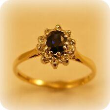 Oval Sapphire & Diamond 9 carat Gold Cluster Ring