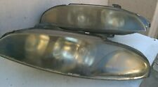 1998 Mitsubishi Eclipse left and right headlamps