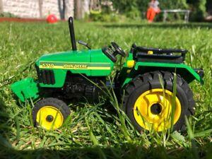 farm vehicle toys....JOHN DEERE TRACTOR MODEL