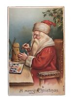 ~SANTA CLAUS in Workshop~with Toys~Pipe~Doll~Antique Christmas Postcard-a58