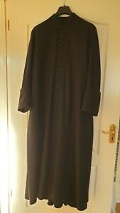 Black Cassock with 39 buttons, with surplice and cincture, handmade by J&M.