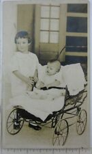1910s RPPC Girl Child Baby in Buggy Postcard Sister Stroller Carriage