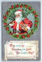 Vintage Christmas Postcard Santa Claus Carrying Tree Toys Holly Border Silver