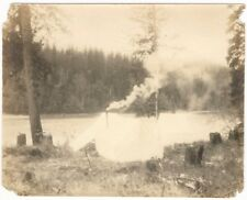 1900s Tents with Smoking Chimney on Woods Riverbank Snapshot