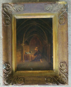 19C. VERY OLD FRAMED PAINTING ON WOOD DEPTICTING MONK KNEELING IN A CHURCH