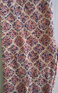 LULAROE    SIZE OS   CREAM LEGGINGS WITH A PINK AND PURPLE DESIGN