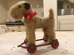 Antique vintage dog on wheels,straw stuffed Irish terrier,pull along toy triang