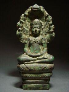 A  RARE BRONZE NAGA PROTECTED BUDDHA, LOPBURI STYLE, KHMER INFLUENCE 18/19th C.