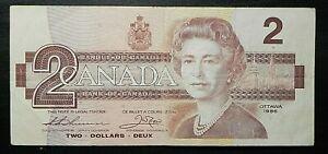 1986 Circulated Canada $2 Two Dollar Birds of Canada BRG Thiessen Crow BC-55b