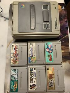 Super Famicom With 6 Games . System And Games Not Tested. Don't Know If Working.