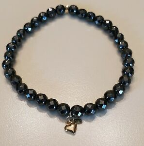 Black Spinel Fauceted Stretch Bracelet With 14K Dangle Heart Charm and Bead.