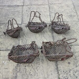 Beautiful and unusual set of 5 antique iron decorative hanging baskets.